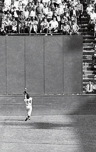 """Willie Mays with """"The Catch"""" during the 1954 World Series at the old Polo Grounds."""