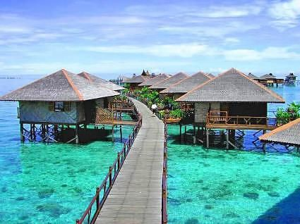 Mabul Island, been there myself. Great place to dive and snorkle, many honeymoon suits and nice restaurant to have lunch