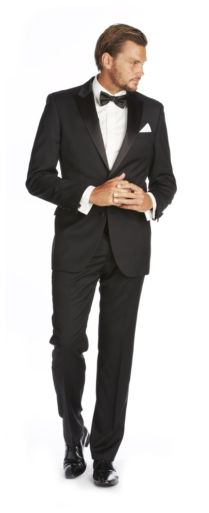 'The Tuxedo' Two buttoned jacket with a satin peak lapel, angled pocket flaps with satin jet trim, with side vents.