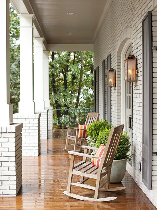 Simply Perfect ~ Just like indoors, simply adding a fresh coat of paint to the exterior of a house can change the entire look. Here, taupe paint gave old red brick a new, cleaner look. Since the porch isn't very wide, the furniture couldn't be bulky. Rocking chairs and potted shrubs convey a simple, symmetrical, and unified look.