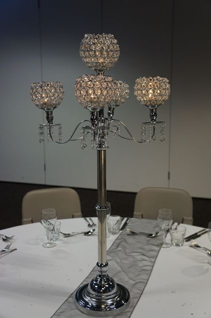 We love these candelabras.  http://www.tailracecentre.com.au/weddings/