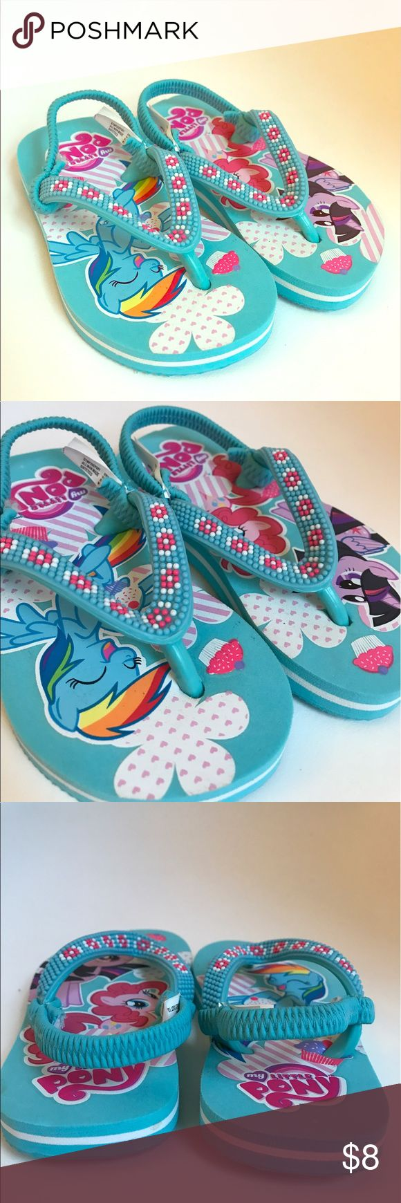 My Little Pony flip flops toddler s 5-6 Adorable flip flips with beaded strap. NWOT never worn. There is a small indention toward the back of one (pictured). It isn't from wear, it just came that way. Toddler girl size small/ 5-6 Shoes Sandals & Flip Flops