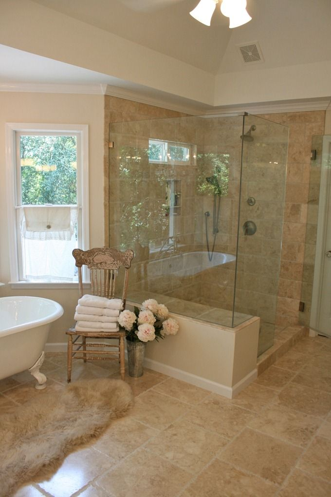 Shower next to claw foot tub except glass up to bathroom ceiling for steam room. NO cathedral ceilings! Been there, done that utility bill!