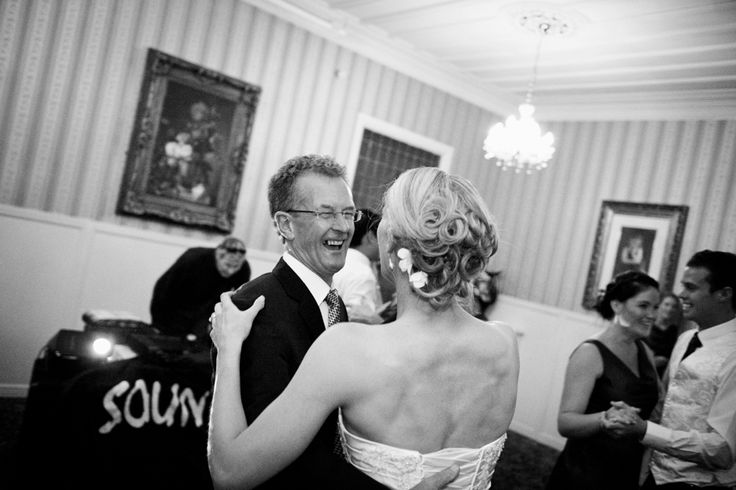 Bride dances with her father after her wedding at Princes Gate Hotel, Rotorua. Black and white. Love Images creates beguiling fine art bridal images for the most discerning clients. We specialise in natural and relaxed photojournalistic wedding photography, supplying the most exclusive albums and prints from manufacturers such as Cypress Albums, Queensberry and Couture Book. We are a high end studio located in the beautiful city of Auckland, New Zealand.
