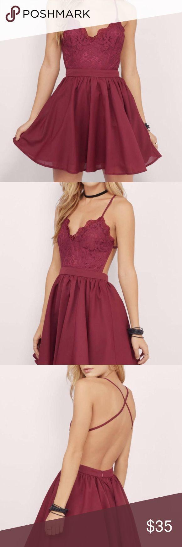 Tobi skater dress maroon skater dress, criss cross straps, backless, tulle underneath the skirt, never worn Tobi Dresses
