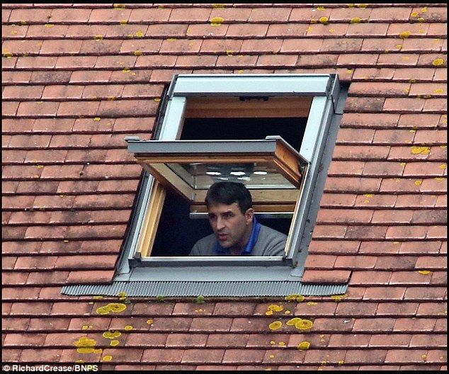 Poole Town boss Tom Killick watches his side's match against Cambridge City from a skyligh...