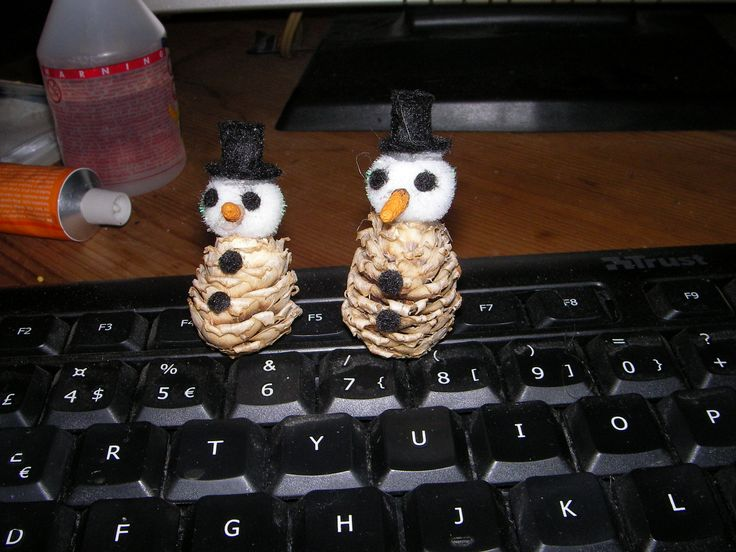 cone snowman,,  bleeched a larch cone , a cottonball head , felt tophat, eyes and buttons.  nose is a birchcone paintet orange