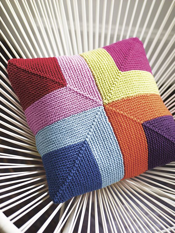 Colourful cushion made using garter stitch squares                                                                                                                                                      More