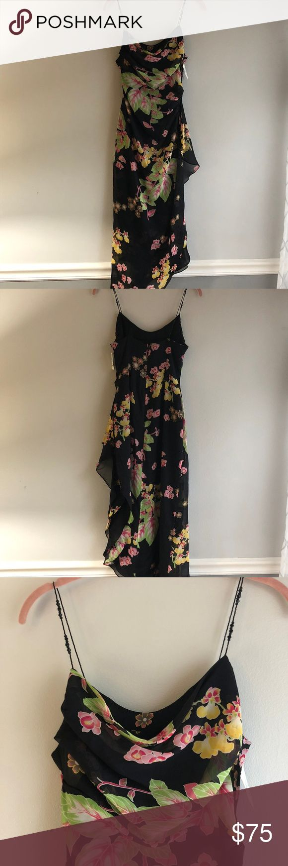 NWT Kay Unger Side Drape Tropical Cocktail Dress Beautiful Kay Unger silk chiffon side drape floral cocktail dress with asymmetrical hem.  Draped empire waist bodice with an overlay, has black beaded straps and side draped floaty silk skirt in a black print of tropical flowers and orchids, in mostly pinks, white, yellows and greens.  Center back invisible zipper. Fully lined with black crepe. Missing one ribbon hanger loop.  Neiman Marcus tag still attached. Kay Unger Dresses Asymmetrical