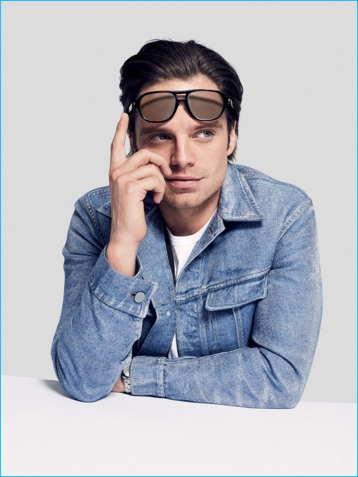 Sebastian Stan rocks Brioni sunglasses with a denim jacket from Calvin Klein Collection.