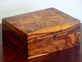Australian colonial tulipwood box. This wonderful Tulipwood box has a segmented inlayed circular star or compass pattern to the top, set within a square frame flanked by square inlays to the side and a fine banded edge. A similar design can be found on a tulipwood box on page 204 figure 77 in the book on Australian Furniture by Fahy and Simpson. The sides are well figured solid tulipwood and cedar secondary timber, original brass hardware and has original patination. X Chantilly Antiques