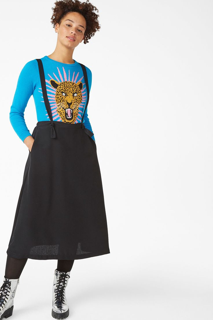 <p>A long skirt in a sporty-luxe fabric and elastic waistband. The two long dungaree straps are detachable and can be tied together to make cool belt detail