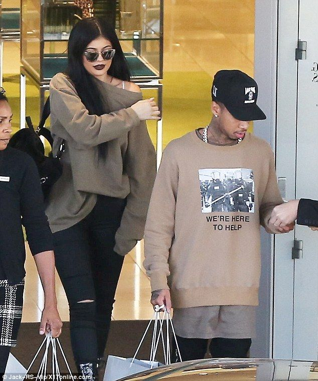 Expensive date: Kylie Jenner and Tyga went on a shopping spree at Neiman Marcus in Woodlan...