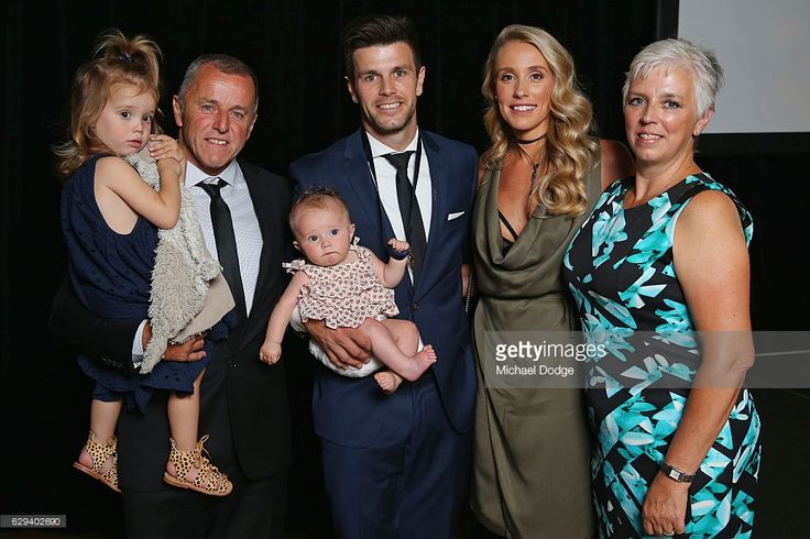 Trent Cotchin of the Richmond Tigers poses with daughter Mackenzie Foxx, his dad Peter holding Harper Foxx, wife Brooke and mum Cath after being presented his Brownlow Medal during the 2012 Brownlow Medal presentation on December 13, 2016 in Melbourne, Australia.