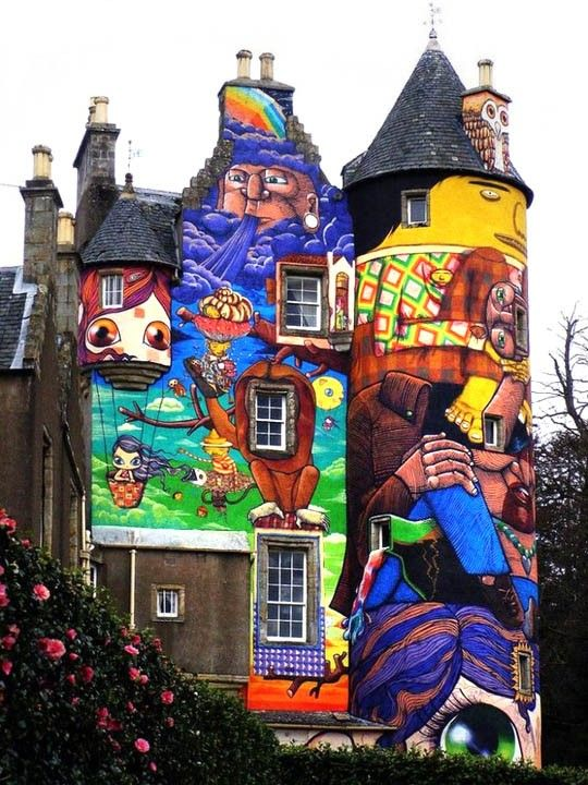 This is the Kelburn Castle in Scotland, close to a wonderfully-named Fairie village (Fairlie, actually) - see here - painted over by Brazillian street artists from Sao Paolo Nina and Nunca Os Gemeos (completed in June 2007):