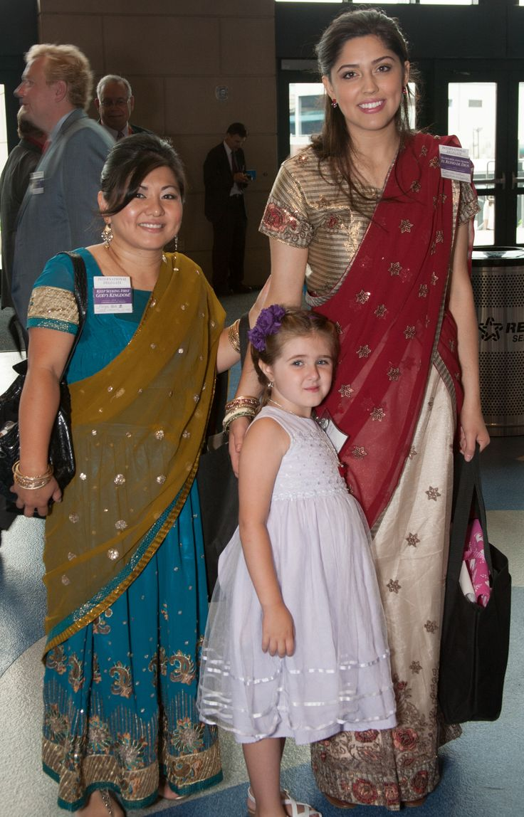 Little girl posing with international delegates -Indianapolis, Indiana International Convention 2014
