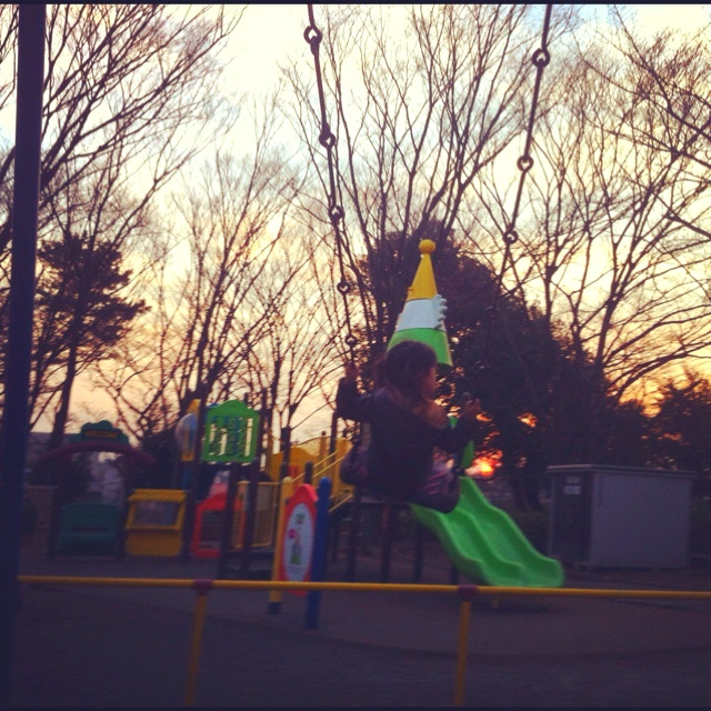 children playing on the swing after sunset is becoming one of rare seen scenes in daily Japanese life.