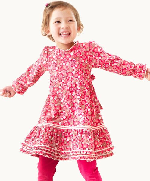 DAISY FIELDS CORDUROY DRESS  Cute and cuddly in corduroy! Daisy Fields is one of our favourite corduroys, and it's easy to see why- a gorgeous strawberry sprinkled with oodles of delightful flowers. The double ribbon trim and hem ruffles finish off this dress to perfection! Perfect for play dates and tea parties!