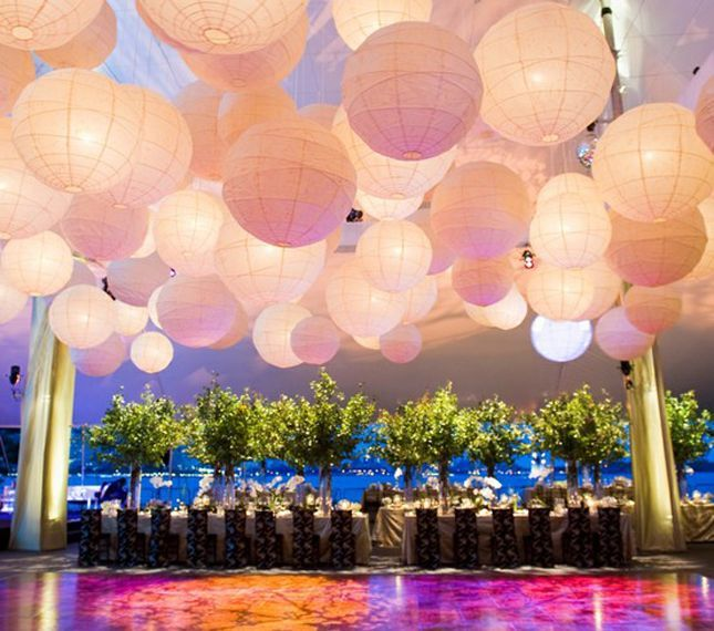 hanging paper lanterns over the dance floor is so pretty! I love white ones with lights in them.