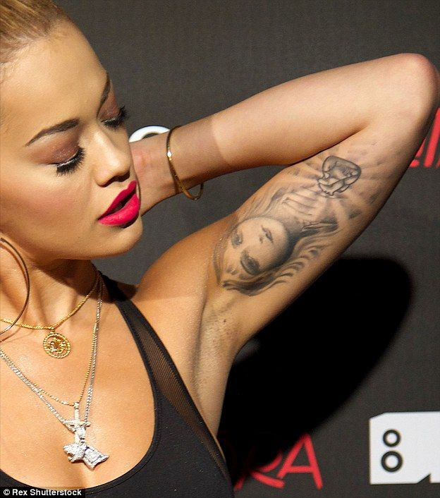 Muscle and art: On her left arm, Ora sports a picture of Aphrodite, the Greek goddess of love