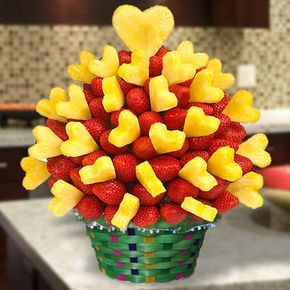 Lovely Strawberry Arrangement - Strawberries and pineapples never delicious like that. You can choose hand-dipped in dark, white or milk chocolate.  This edible fruit arrangement is specially for your happy moments. You can create your own edible fruit arrangements. - www.VaaV.ca