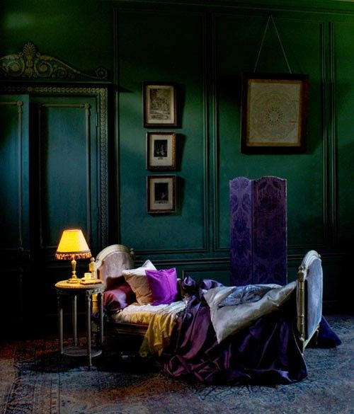 This gorgeous emerald room (photographed by Didier Delmas) is a dark, dramatic French bedroom.