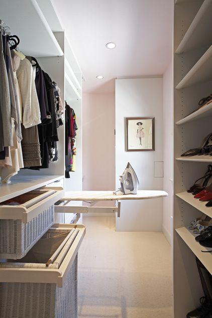 Love the idea of iron and laundry hampers in a closet/wardrobe contemporary closet by Lisa Adams, LA Closet Design