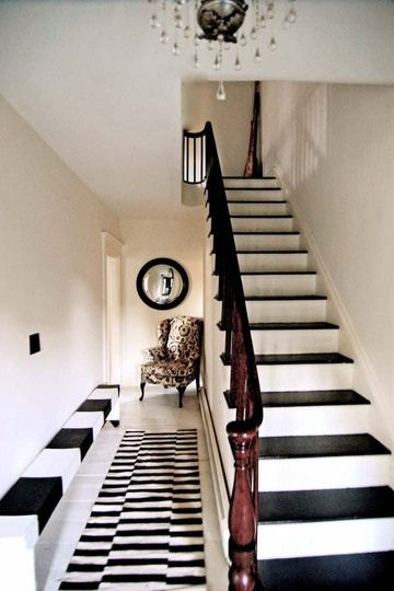 Love this black & white hallway and stairs...