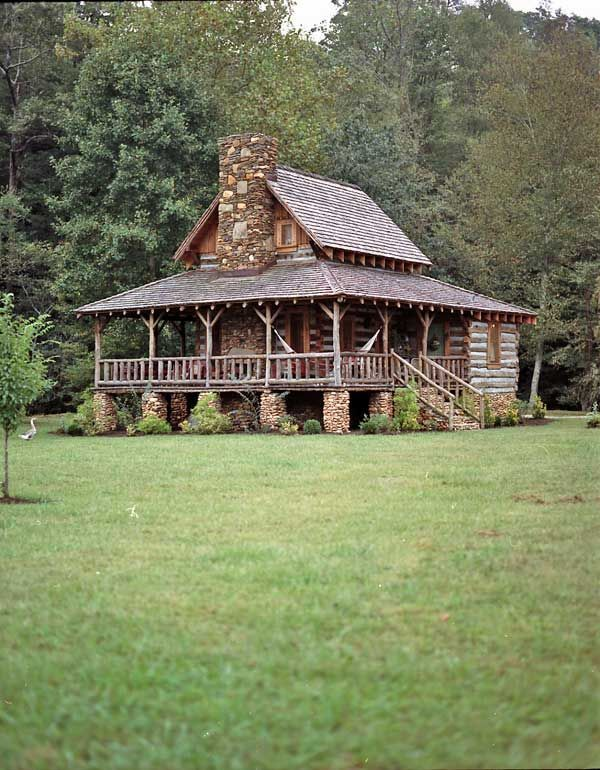 The 500-square-foot home was handcrafted by local builder Kevin Thomas from old tobacco barns, 1920s windows and river rocks.