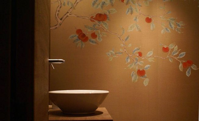 Kaki fruits bloom from the bathroom wall, with Misha's handmade wallpaper