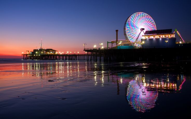 Santa Monica Beach - California's much-loved playground, Santa Monica Pier boasts rollercoasters, amusement arcades, numerous shops and cafés, a whirling carousel and an aquarium.