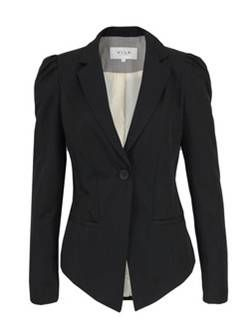 A black corporate jacket is enlivened by African fabrics or accessories