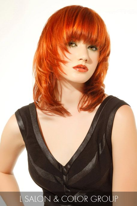 Beautiful hair comes alive with this vibrant auburn hair color on lustrous, silky layered lengths.