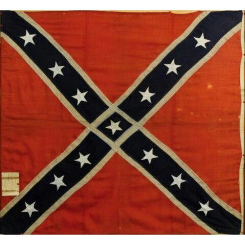 "Battle flag of the19th South Carolina infantry regiment . The flag is one of just six known examples of ""Macon Arsenal"" banners, produced in Macon, GA. The wool flag is approximately 48 inches by 52 inches. Macon Arsenal flags are distinctive because the white Cross of St. Andrew extends through the center, isolating the banner's center star.Unlike most South Carolina regiments, the 19th South Carolina spent the majority of the war fighting in the west, and was attached to the Army of…"