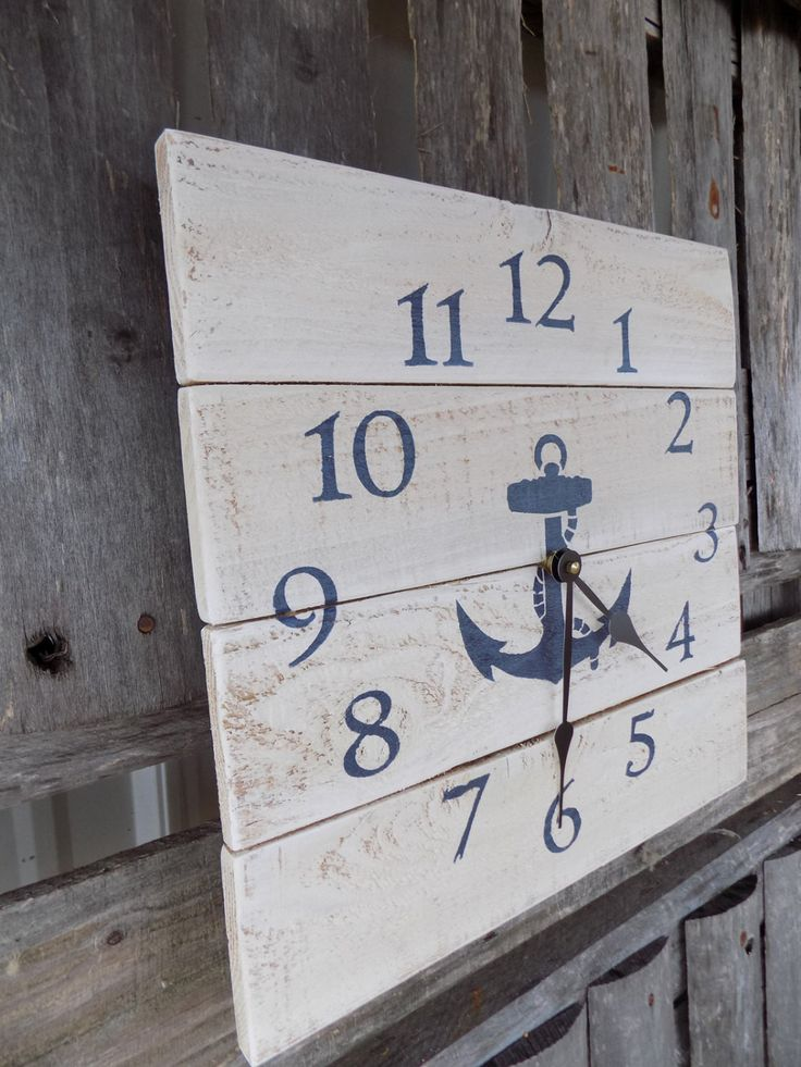 This beach themed clock has been rustically painted an off white, with navy blue…
