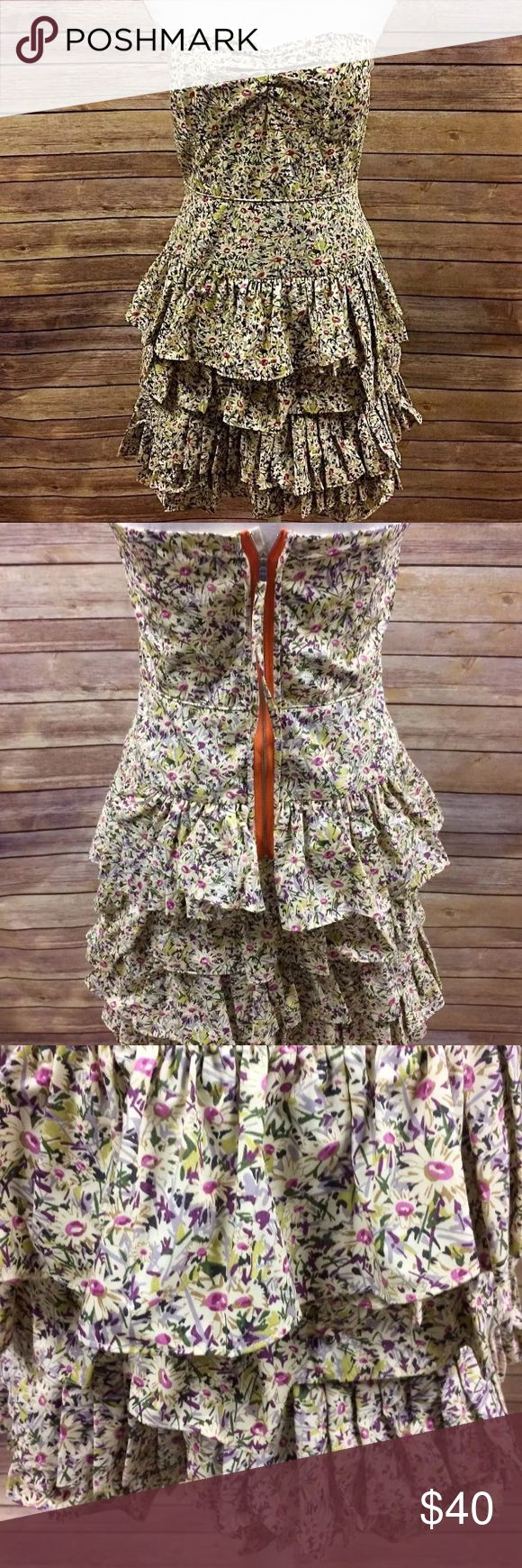 """J Crew Daisy Day Strapless Ruffle Dress Sz 4 I love the thick feel of this fabric! Beautifully stiched.  Brand: J Crew Silouhette: Strapless Tiered Dress Color: Multicolor Floral Size: US Womens 4 Style# 26644 Lined: Yes  Features: Built in bra support hook (see photos) Materials: 100% Cotton  Measurements in Inches laid flat Waist: 14.5""""  Armpit to Armpit: 16"""" Sweep: 22"""" Length: 28""""  Dress doesnt quite zip up the back of the mannequin for reference  Mannequin Specs Height without Base: 28""""…"""