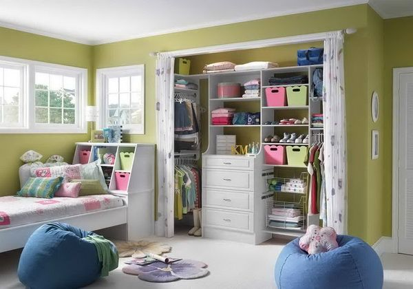 Kids Closet Organizers Design- love the drawers and use of hanging rods on the sides