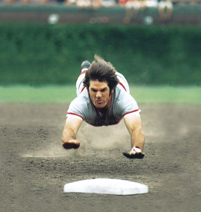 Pete Rose dives into third base during a 1975 game between the Cubs and Reds. (Heinz Kluetmeier/SI)