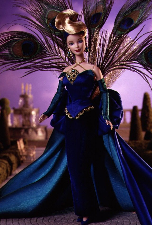 """What is it with me and peacocks? I just love the colors, the blending on the feathers, the richness! And of course, the aptly-named The Peacock™ Barbie® Doll is gorgeous even with her own """"tail"""" feathers (which, by the way, are only on male peacocks). She retailed for $99 back in 1998 as part of the """"Birds of Beauty"""" collection."""