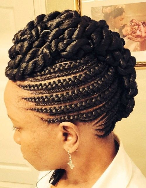 The Ghana rows are cleanly made in semi-circular lines which, some of which meet the Mohawk at the nape, crown and some moving parallel to it. The Mohawk look is artfully crafted by twisted intertwining braids which start at the top of the head going down to the nape. It's beautiful.