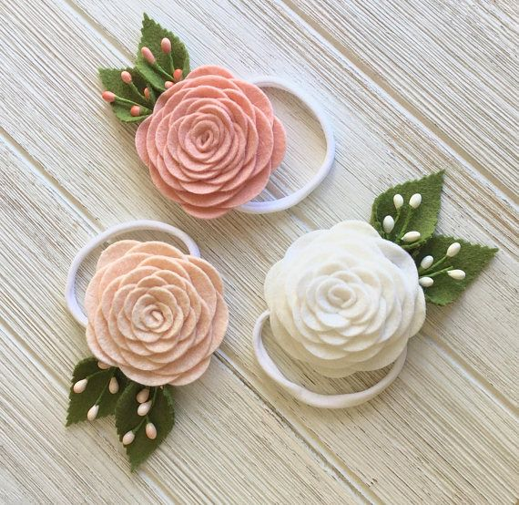 These beautiful felt rose headbands are the perfect accessories for Easter, a baptism, first communion or even a wedding! This listing is for one headband. At checkout, you can choose from three spring colors- bright white, pale pink, or medium pink. Each headband is handmade with