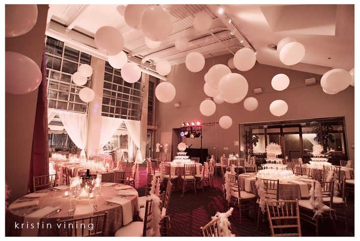 What a different effect the use of balloons can have when they are hanging from the ceiling or flying high but mid air as opposed to flying high with helium and touching the ceiling