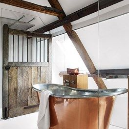 Farmhouse style by Pippa Paton Design Featuring the William Holland pure copper bath, as seen in @houseandgarden Magazine  www.williamholland.com