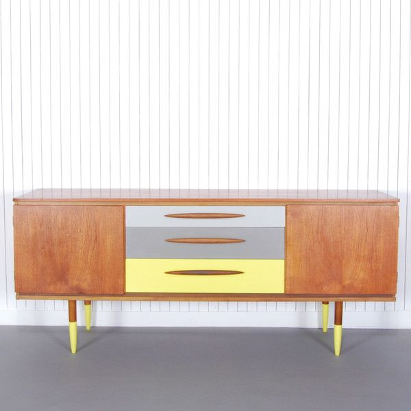 Easton - £470.00 - Easton, a 1950s sideboard has been finished with colour blocked yellow and grey drawers and dip painted yellow feet to emphasise the retro features of this mid-century piece.