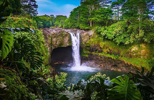 RAINBOW FALLS  .   This 80ft plunge waterfall flows over a natural lava cave surrounded by lush tropical rainforest.... and even some fresh ginger! Its also the mythological home to Hina the ancient Hawaiian goddess of the moon.   TIP: Arrive before 10am to have the ideal lighting for rainbow sightings through the mist thats thrown up from the waterfall  .  Would you hike to the top to explore? .  . . . . . . .  @theislandofhawaii  @gohawaiica  #rainbowfalls #WaiānuenueFalls #waianuenuefalls…