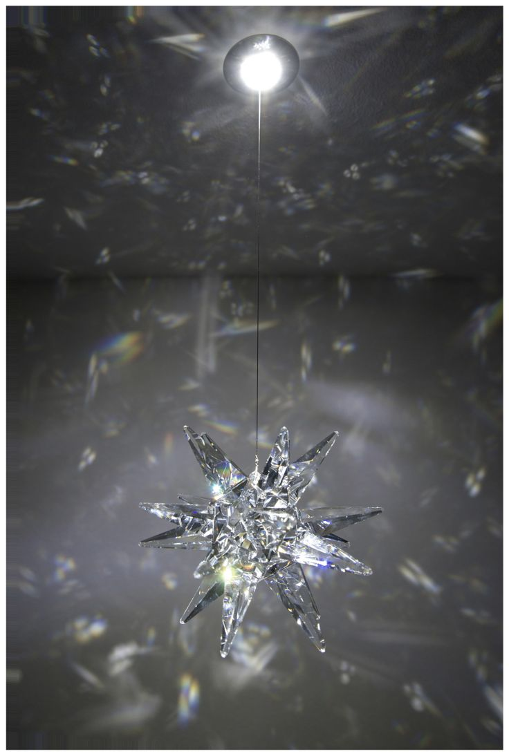 FLOP MORAVIAN STAR - LED spotlight made of stainless steel with crystal component. MADE WITH SWAROVSKI COMPONENTS.