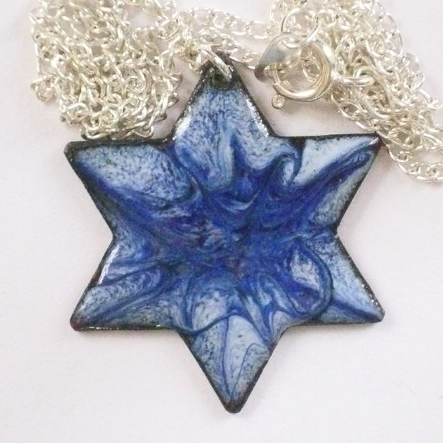 pendant - 6 pointed star scrolled dark blue and purple on pale blue £7.50