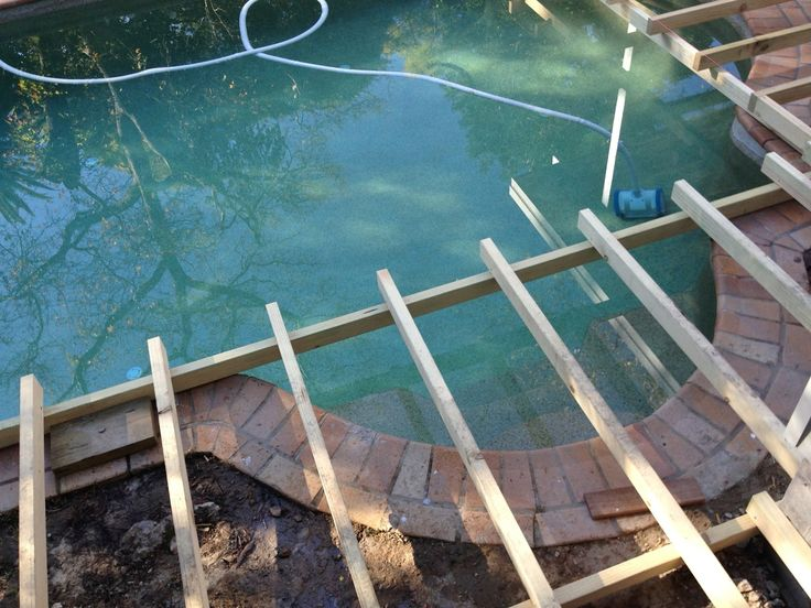 Straight Edge Deck Over Curved Pool Landscape