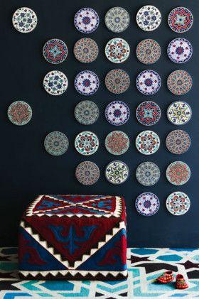 Kyrgyzstan ottoman and Turkish tiles on the wall.
