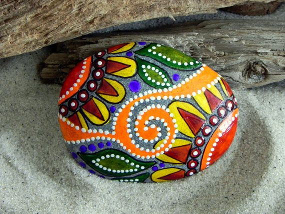 ~Painted Rock (sea stone) from Cape Cod.  Bring a piece of the shore inside...    Sweet happiness in this painted sea stone. The design hints at a beautiful Moroccan sunrise. Oh-so-smooth and feels wonderful in your palm. Happy colors of yellow, tangerine, cinnamon, greens, purple,black and white in layered water-resistant glaze inks dance upon this happy stone. The back is signed and dated, with serenity sea stone ~ cape cod hand lettered.    A generous portion of each sale is donated to…